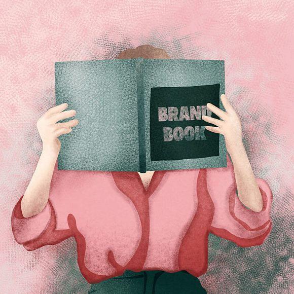 ilustracja osoba trzyma brand book